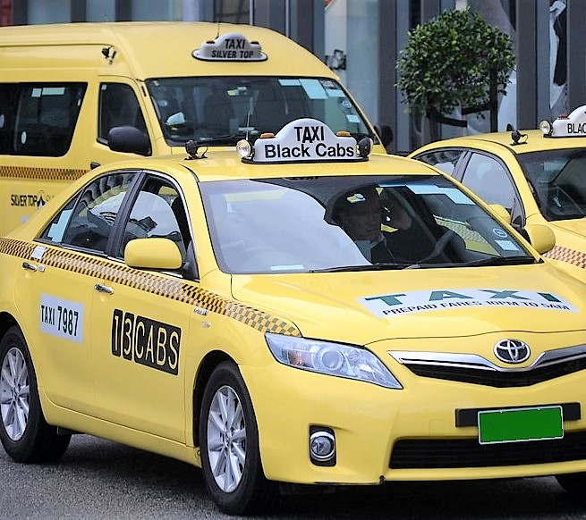 An image of 3 Taxi's one being a Toyota Camry & the other a Toyota Hiace