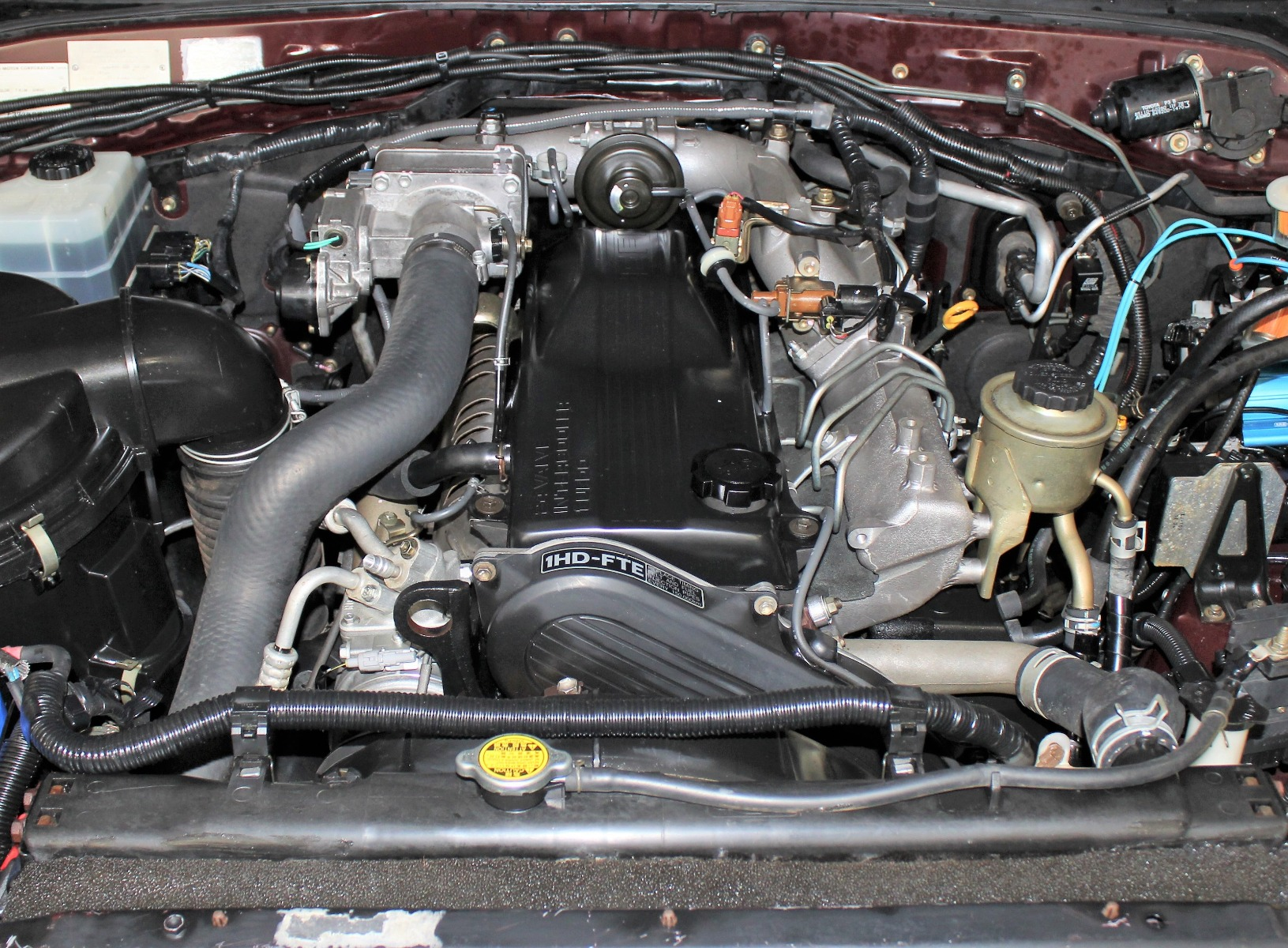 A Landcruiser engine bay fitted with a 1HD-FTE Engine