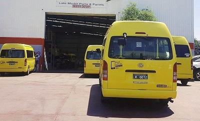 taxi hiace commuter bus waiting to be serviced